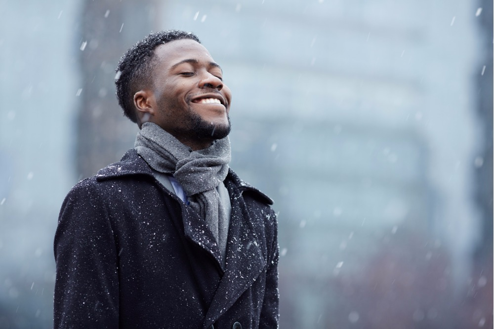 happy-man-in-snowfall-picture-id679218430